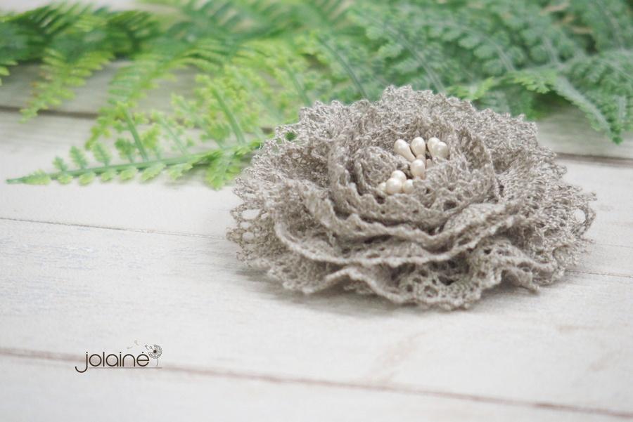 Lininė sagė gėlė